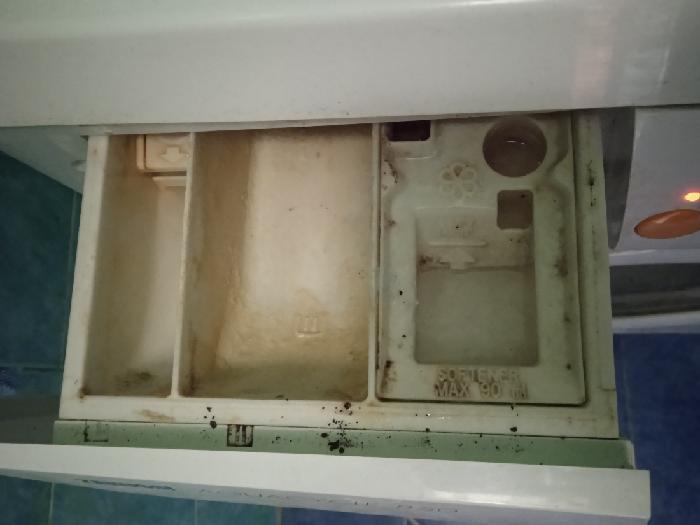 как очистить лоток от стирального порошка
